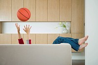 Boy Playing with Basketball