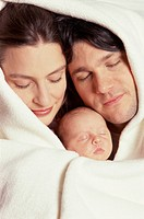 Parents and Baby with Closed Eyes