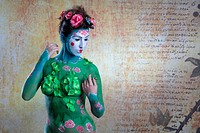 Young woman with traditional Asian body painting