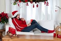 Girl writing wish list for Christmas