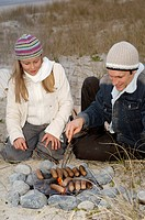 Father and Daughter Grilling on Open Fire New Zealand