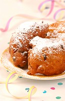 Raisin Crulles with Icing Sugar on a Plate