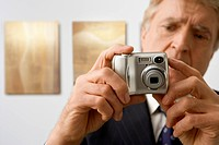 Man with Digital Camera in a Gallery