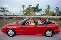 Family in Convertible Sports Car, Summer, Miami, Florida, USA