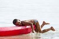Young boy playing in the ocean at Starfish beach on Isla Colon, Bocas del Toro, Panama