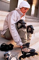 Young Woman Putting Inline Skates On
