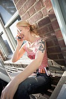 Woman on Fire Escape Talking on Cell Phone