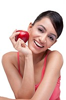 Portrait of cheerful young woman with fresh apple