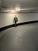 Businessman in Parking Garage