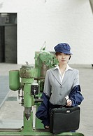 Business Woman in a Factory