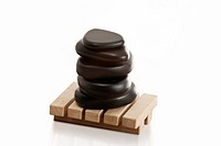 Stacked massage stones on wooden base