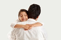 Father and daughter embracing over white background