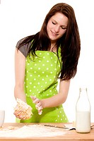 young woman handling dough