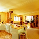 Side view of a kitchen adjoining the study room is seen with yellow painted walls
