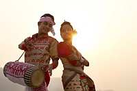 Bihu dancers standing back to back