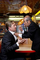 Two Businessmen Fighting in a Cafe