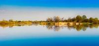 Sky reflection on lake.