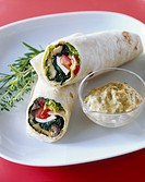 Tofu, aubergine and spinach wraps with dressing