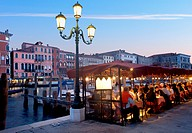 Tourists at a sidewalk cafe along a canal, Grand Canal, Venice, Veneto, Italy