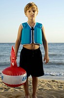 Boy in Life Preserver with Float Toy