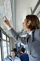 Businessman Checking a Route Map on a Train