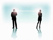 Silhouette of business man and woman communicating
