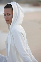 Woman in Hooded Sweatshirt at Beach