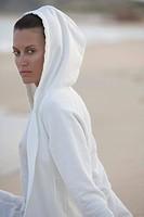 Woman in Hooded Sweatshirt at Beach