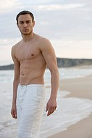 Barechested Young Man on Beach