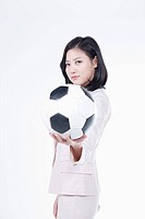 A woman holding the soccer ball