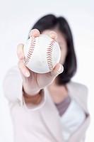 A woman holding the baseball