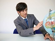 Young Businessman Looking at Globe