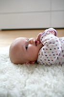 Baby Girl Lying on Rug