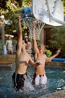 Teenage Boys Playing Basketball in Pool