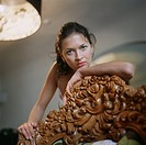 Young Woman Leaning on an Intricately Carved Chair