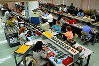 Workers in Electronic Assembly Area