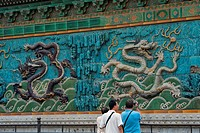 China, Beijing, Forbidden City,People Looking At Dragon Screen