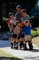 Family Inline Skating on a Sidewalk