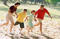 Family Running at Park
