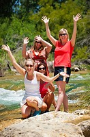 Group portrait of 4 women, all 45 years old caucasian, at the Frio River in Concan, Texas, USA