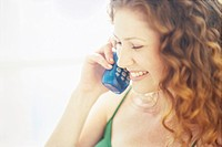 Woman Speaking on Telephone