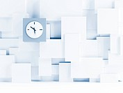 Clock on a wall consisting of white cubes as backg