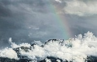 Storm clouds with a rainbow, Southern Alps, Fox Glacier, South Island, New Zealand