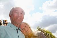 Older couple standing outside together