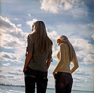 Young Women Standing on a Beach