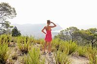 Hiker overlooking hilltop landscape