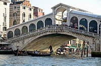 Italy, Venice, Gondolas beneath Rialto Bridge on Grand Canal