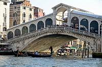 Italy, Venice, Gondolas beneath Rialto Bridge on Grand Canal