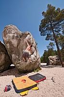 Hiker scaling steep boulder