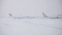 Grounded Aircraft at a major London airport in heavy snow, blizzard and adverse weather conditions